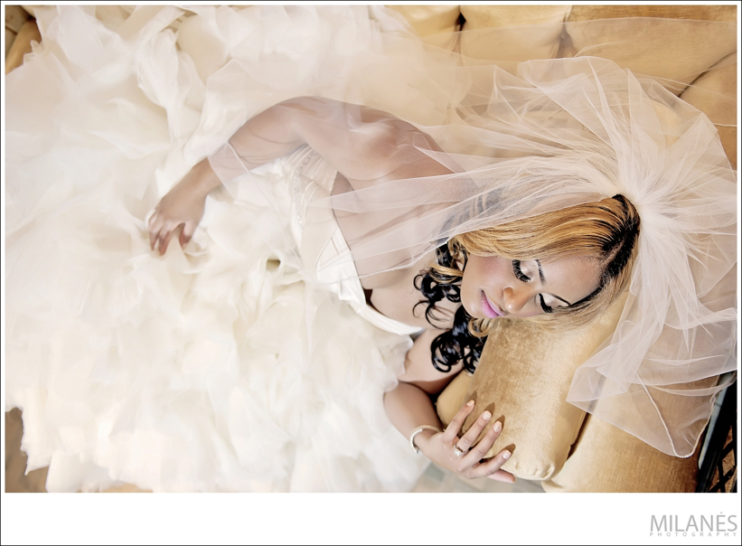 bride_laying_down_couch_portrait_veil_dress