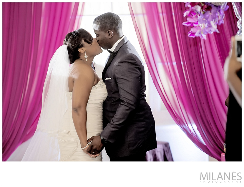 wedding_ceremony_bride_groom_kiss_pink_alter