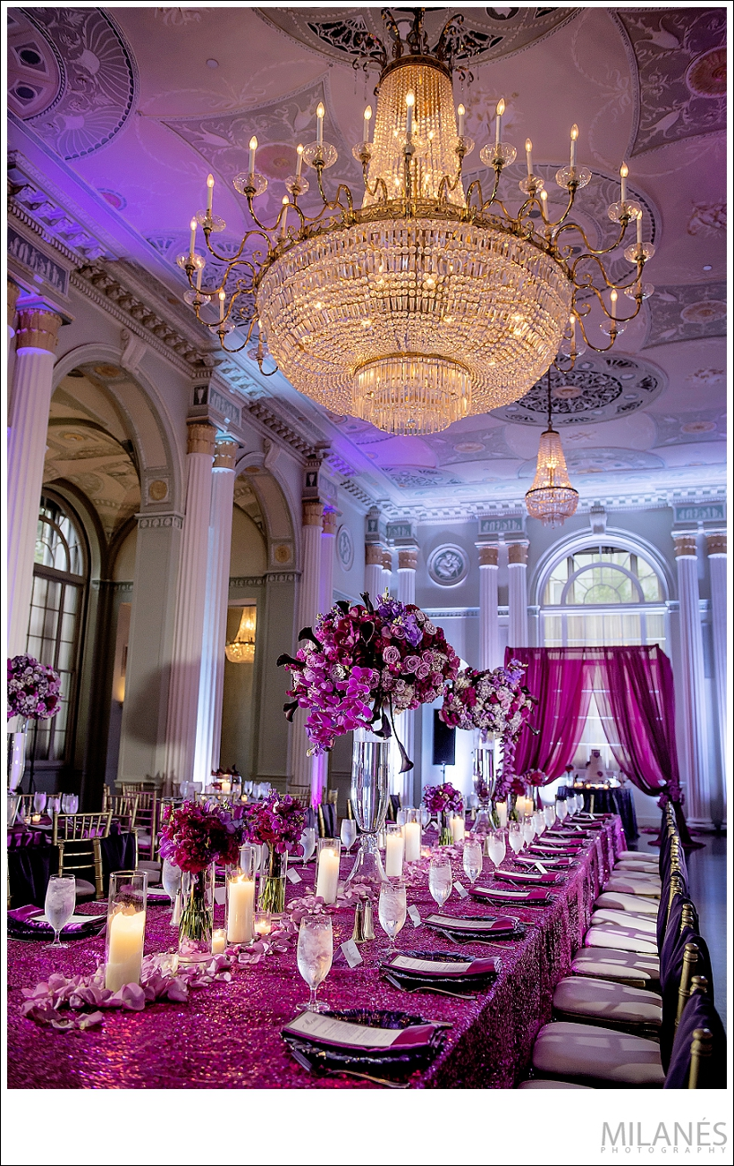 wedding_reception_chandelier_flowers_beautiful_luxurious_purple_pink_teal_candles