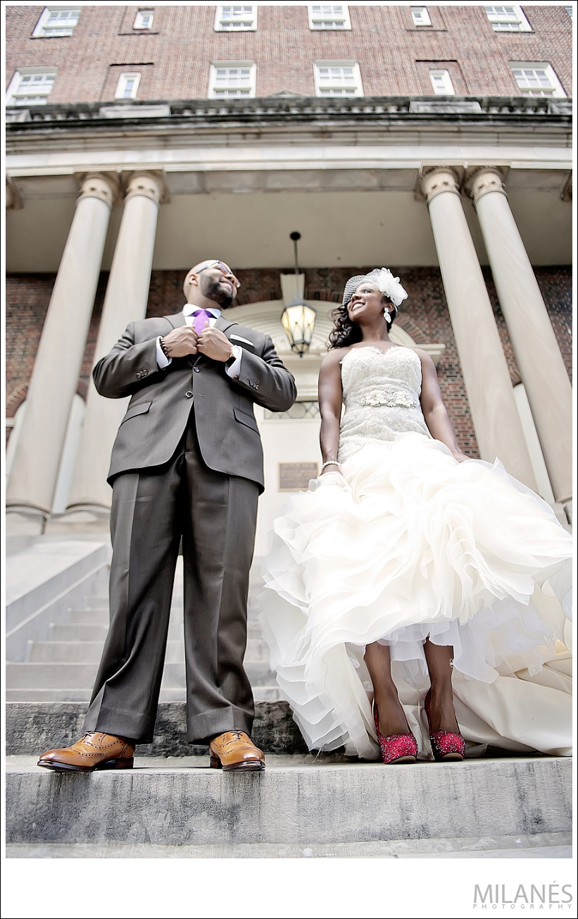 wedding_bride_groom_smile_together_stairs_outside_biltmore_city_red_shoes_purple_tie_white_dress_beautiful_creative_modern_ideas