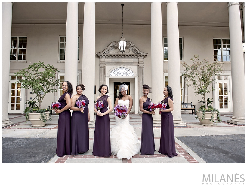 wedding_party_bride_bridesmaids_white_dress_purple_red_boquettes_outside_city_pillars_beautiful_creative_modern_ideas