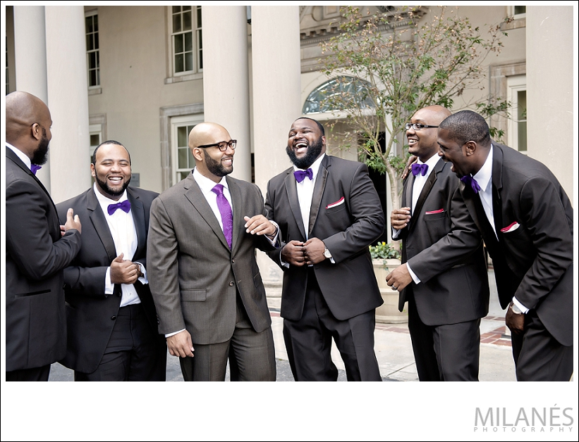 wedding_party_groom_groomsmen_black_purple_suits_outisde_city_laughing_fun_creative_modern_ideas